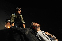 """BoHo's Epic 'Floyd Collins' Is A Visceral Masterpiece  1 """"Only heaven knows how glory goes; What each of us was meant to be"""". That manifest destiny is what our doomed cave explorer ponders in Bohemian Theatre Ensemble's majestic new production of Floyd Collins, the 1996 musical written by Steppenwolf's Tina Landau and Adam Guettel (The Light In The Piazza)."""